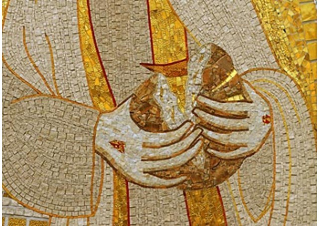 Jesus bryter brødet.jpg