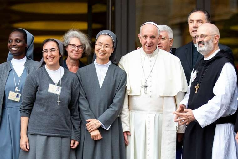 Sr_Nathalie_Becquart_third_from_left_poses_with_Pope_Francis_and_others_during_the_youth_synod_in_2018_Credit_Daniel_Ibanez_CNA.jpg